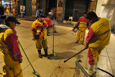 Gum-cleaners of Mexico City removing chewing gum from the pavements