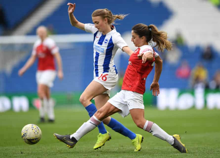 Brighton's Ellie Brazil is challenged by Danielle Van de Donk of Arsenal during last season's league match in Brighton.