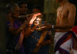 People offer prayers during Diwali at a temple in Colombo, Sri Lanka