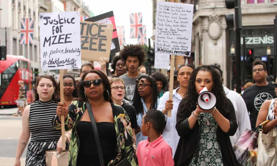 Black Lives Matter protesters on a solidarity march for Mzee Mohammed, an 18 year old black youth who died in police custody in Liverpool. The report found that black people are treated more harshly in the criminal justice system.