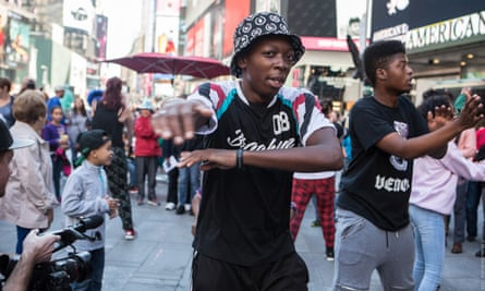 """Breakdancers in Times Square part of a performance called Graphic Cyphers promoted and co-produced by It's Showtime NYC""""s parent organisation Dancing in the Streets."""