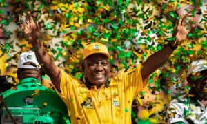 South African president Cyril Ramaphosa waves at supporters at the Ellis Park stadium in Johannesburg