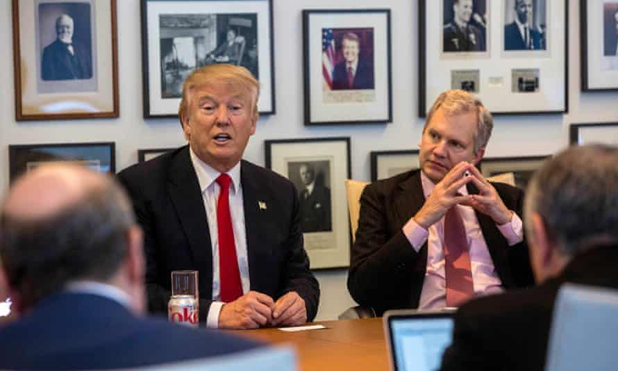 Sulzberger Jr listens during a meeting between editors and reporters and then president-elect Donald Trump, at the New York Times in November 2016.