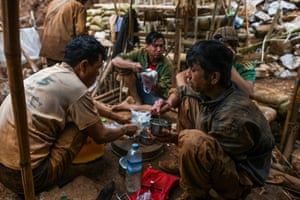 Miners eating at a ruby mine in Mogok, north of Mandalay