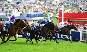 The crowds on the Epsom Downs for last year's Derby. The Jockey Club has confirmed its commitment to staging this year's Derby and Oaks at the track.