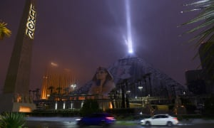 The light of the Luxor pyramid hotel and casino shines through a rare snowfall in Las Vegas.