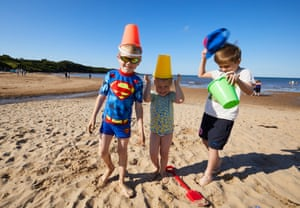 Seven-year-old Luca Petersen dressed as Superman on Lligwy Bay beach