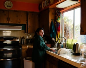 Maria Caceres washes dishes after lunch.