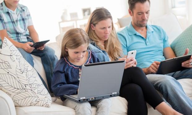 theguardian.com - Michael Savage - Limit your own screen time, parents are urged