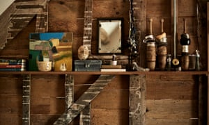 Second growth: favourite ornaments and artworks displayed on the exposed timbers of one of the old walls.