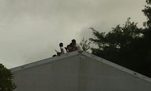 Teenage boys on top of the roof of a tent in RPC3 during fortnight-long protests by refugees and asylum seekers in Nauru