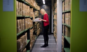 A member of staff in the repositories of the National Archives in Kew.