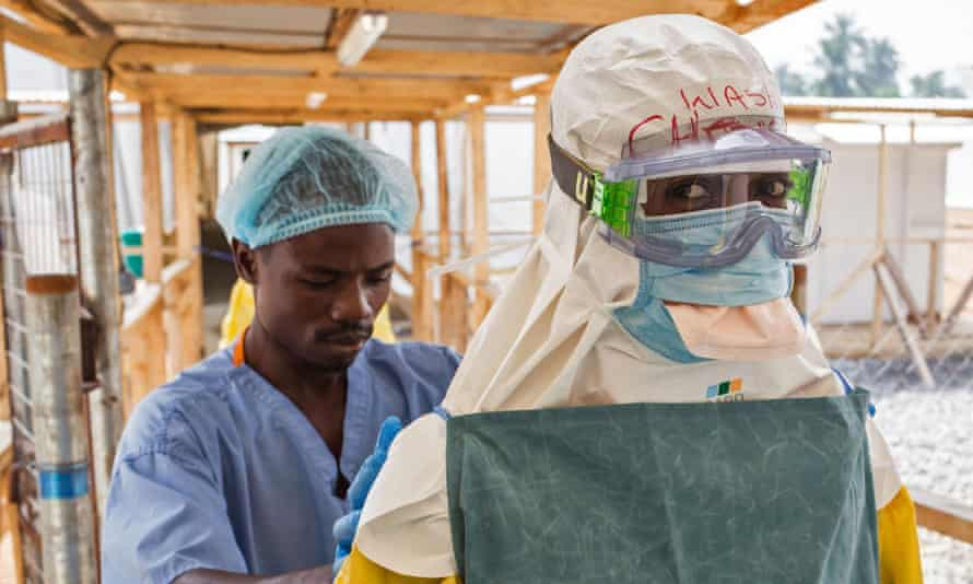 Health care workers prepare to entering a high risk zone at an Ebola virus clinic in Sierra Leone, where the diagnostic kit has been undergoing tests.