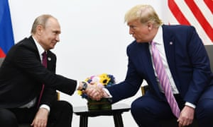 Trump with Vladimir Putin at the G20 summit in Osaka on Friday.