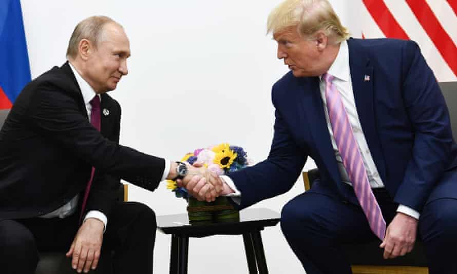 Vladimir Putin and Donald Trump at the G20 summit in Osaka in June.