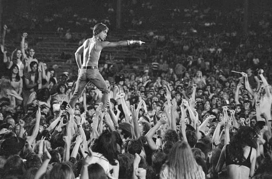 Iggy Pop rides the crowd during a Stooges concert at Crosley Field, Cincinnati, on 23 June 1970.