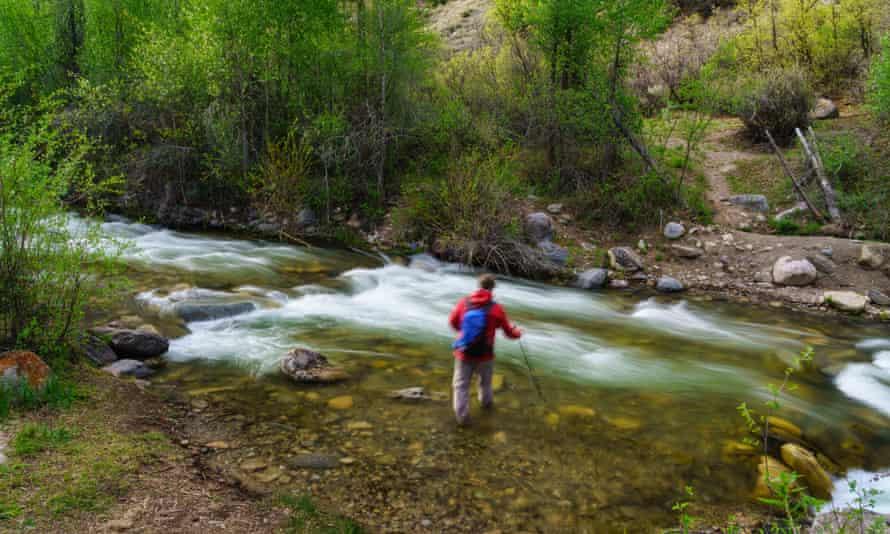 Man crossing a stream