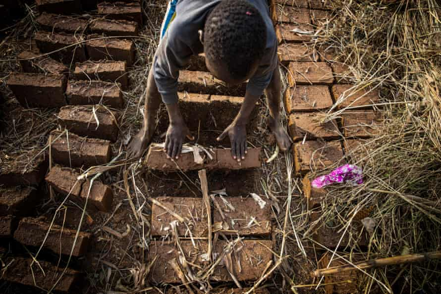 Ambrose, 11, works at a brick-making site with his mother in Uganda.  Child labor has increased significantly during the pandemic.