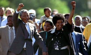 Nelson Mandela is accompanied by his then wife Winnie, moments after his release from prison near Paarl, South Africa on 11 February, 1990.