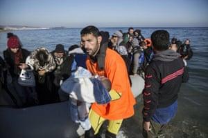 man baby boat raft water sea ocean Greece refugee
