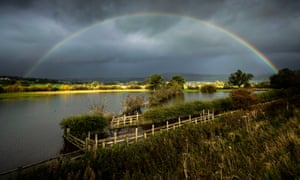 A rainbow over a flooded field near Steeton in Yorkshire