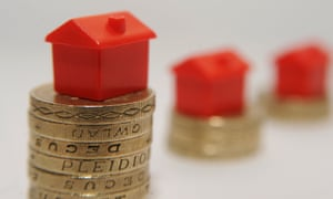 Monopoly hotels on stacks of pound coins getting smaller and further away