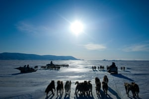 Dog teams and Inuit hunters in Qaanaaq, Greenland, heading out in the spring during the period of the midnight sun.