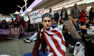 Demonstrators shut down the traffic loops at LAX during a protest against the travel ban.