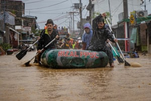 Rescuers try to reach stranded residents in Rodriguez in Rizal