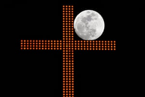 A cross in downtown Beirut, Lebanon, frames the moon