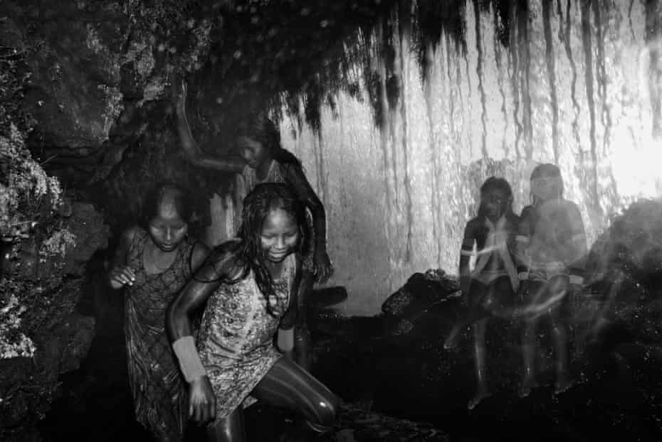 Kayapo children play behind a waterfall in the Kuben-Kran Ken village in the southern Para. The Kayapo's territory is the largest tropical protected area in the world, more than 3.2m hectares of forest and scrubland containing many endangered species. It serves as a crucial barrier to deforestation advancing from the south.