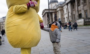 Pokemon entertains a two-year-old in Trafalgar Square.