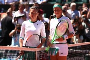Romania's Simona Halep and Jelena Ostapenko of Latvia pose for the cameras before the final.