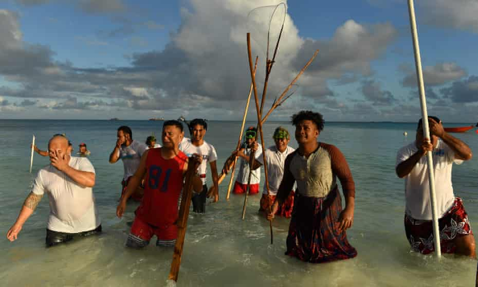 Traditional fishing methods are used to round up fish during the forum.