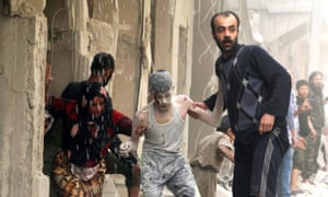 A wounded boy is helped out of a ruined building after an air strike on the Fardous neighbourhood in Aleppo.