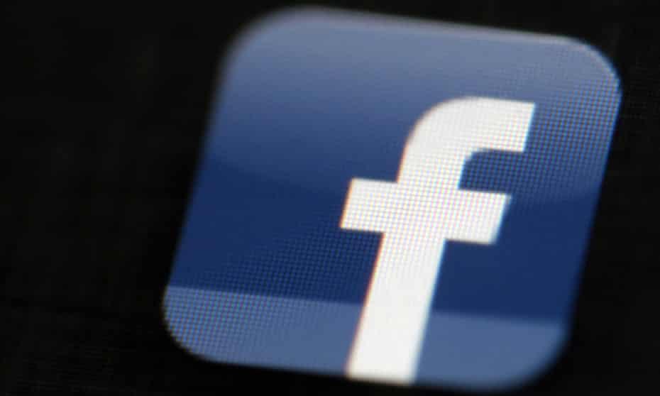 Facebook logo on a phone screen