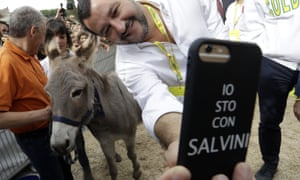 Matteo Salvini takes a selfie with a donkey at an event in Rome's Circus Maximus