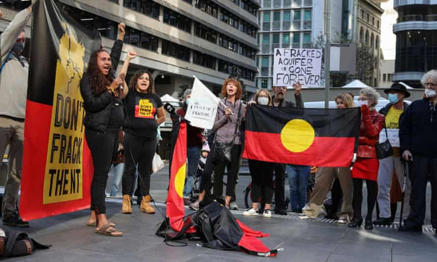 Protesters with Aboriginal flags outside Empire Energy's offices in Sydney in May