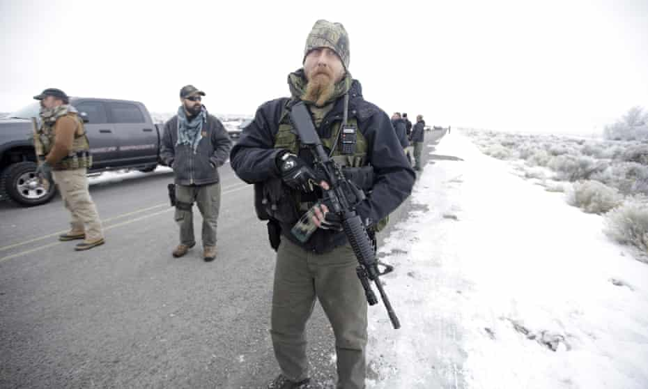 A man stands guard at the Malheur national wildlife refuge in Oregon to protest federal land use policies.