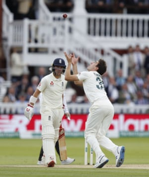 Australia's Pat Cummins takes the wicket of England's Jason Roy.