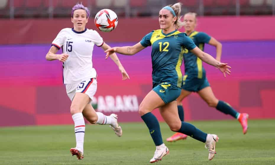 Australia's Ellie Carpenter under pressure from Megan Rapinoe of the US at Kashima Stadium.