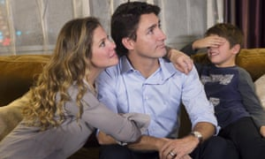Justin Trudeau Xavier Trudeau Sophie Gregoire<br>Xavier Trudeau, right, covers his eyes as Liberal leader Justin Trudeau watches the election results with his wife Sophie Gregoire at a hotel in downtown Montreal.