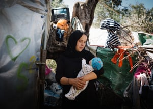 Resident Halime, from Afghanistan, with her 12-day-old daughter