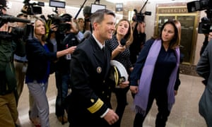 Ronny Jackson (centre) is followed by members of the media following a meeting in Washington DC.