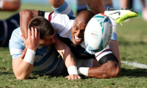 Marcel Brache of the US (right) tussles for the ball with Argentina's Gonzalo Bertranou.