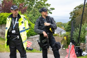 Armed police work a checkpoint at Carbis Bay