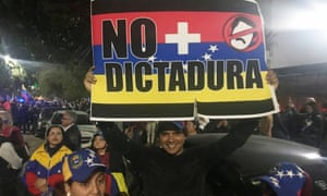 Venezuelan exile Albert Molina protesting in Mexico City. 'We we want to go back to rebuild,' he said.