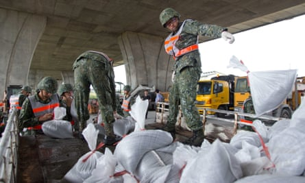 Soldiers distribute sand bags to residents in Ilan county, north-east Taiwan, on Thursday before super typhoon Nepartak makes landfall.