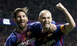 Lionel Messia and Andres Iniesta celebrate.