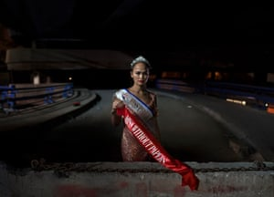Miss Without Papers, Beirut FictionsA Filipino masseuse poses near the Beirut bus terminal, again with beauty contest-style sashes created by Kranioti
